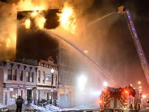 Schenectady building fire leaves and firefighters covered ...