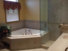 corner tub bathroom ideas inspiring corner jacuzzi tub bathroom designs with polished brass handheld shower heads and