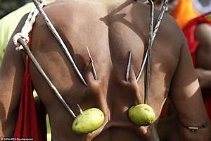 Men in Bangladesh hang themselves from hooks in Charak ...