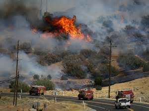 <b>Fire</b> trucks move along Highway 178 near <b>Lake</b> <b>Isabella</b>, Calif., June 24 ...