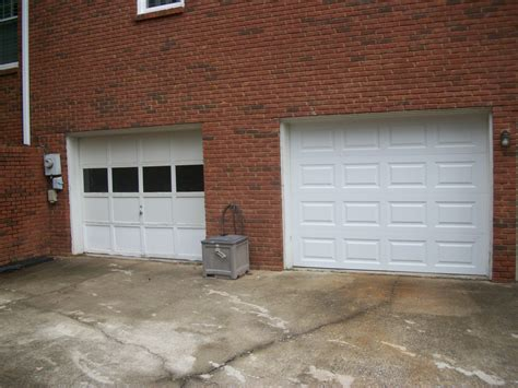 cost of garage door tips choose a new door wisely with cost to replace garage