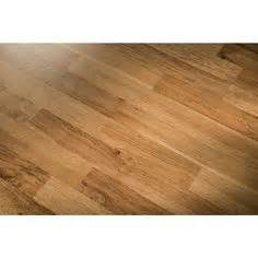lowes flooring tavern oak style selections tavern oak embossed laminate wood planks it s so tempting to make every room a