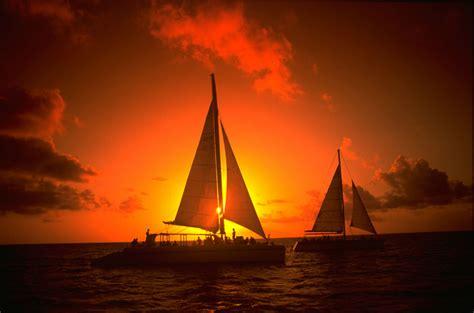 aruba sunset sailing sailboat sail history cruise beach sunsets hyatt beaches travel marketing select regency heritage caribbean blogs casino spa
