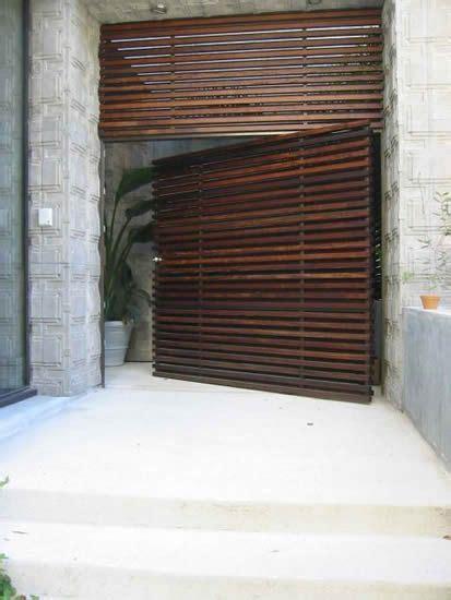 slatted wood door design architecture exterior design