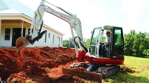 takeuchis   ton excavator features spacious cabin  easy  service heavy equipment guide