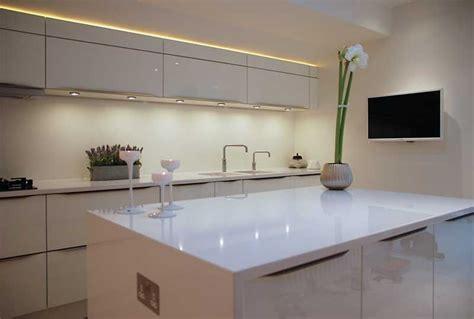 high gloss white kitchen  white quartz worktops