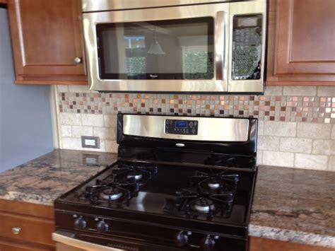 crema bordeaux granite countertops black and stainless