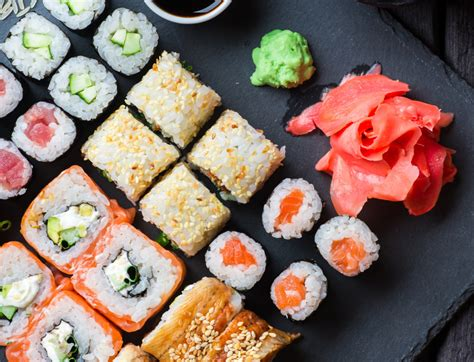 puzzle cuisine sushi served on black jigsaw puzzle in food bakery
