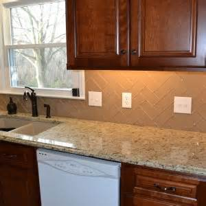 kitchen sink backsplash decor tips glass subway tile in herringbone backsplash with kitchen sink and faucets