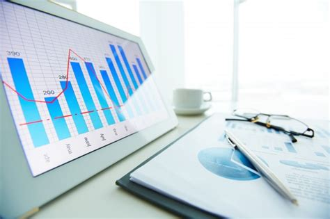 free background report up of pen on financial report with window background