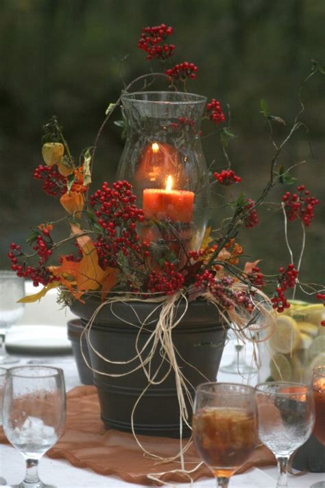 diy fall wedding centerpiece rubbed bronze spray painted clay pot hurricane globe leaves