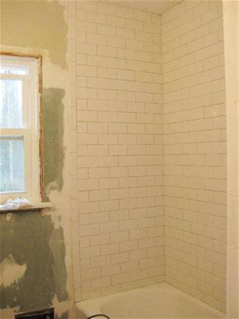 how to install subway tile in a shower marble floor