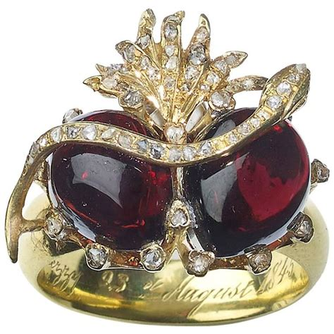 snake and double garnet ring at 1stdibs