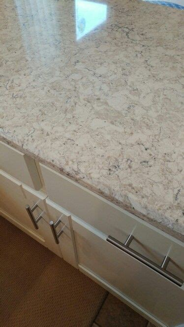 lg aria quartz  creamy white cabinets