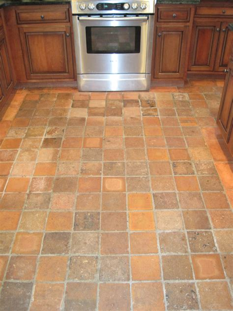 tile ideas for kitchen floors square brown tile kitchen floor combined with brown wooden cabinet with silver stove oven