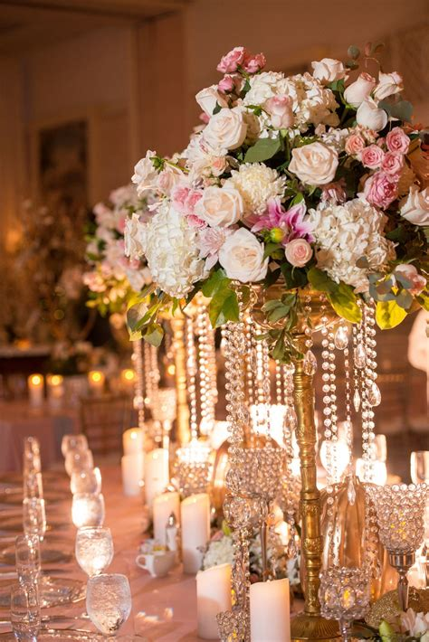cinderella inspired reception table  lush flowers