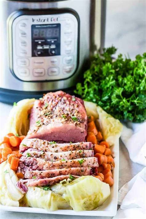 Talk about comfort food such as this fork tender and fall apart beef! instant-pot-corned-beef-and-cabbage-1 | This Farm Girl Cooks