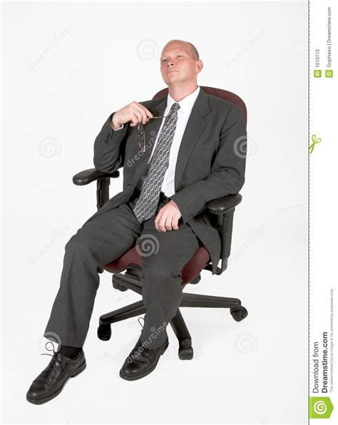 leaning back in his chair stock photos image 1013713