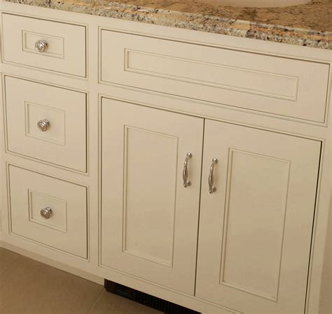 inset shaker style doors with cove crown and light made cabinets serving massachusetts for high end