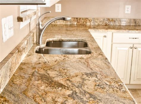 yellow river granite with white cabinets home design