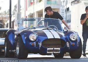 aaron paul mother aaron paul goes for a spin in his blue and white vintage