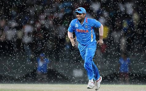 Download 640x960 Suresh Raina Indian Batsman Criketer In Ground During Rain Wallpaper