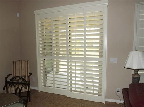 plantation shutters  sliding doors spaces traditional