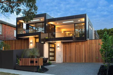 Best Interior Designed Homes - bold square shapes on the exterior and contemporary interior design define this black rock