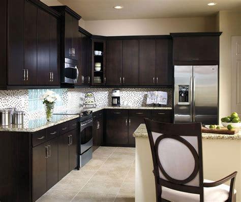 lights for cabinets in kitchen aristokraft maple sarparilla cabinet door style 9695