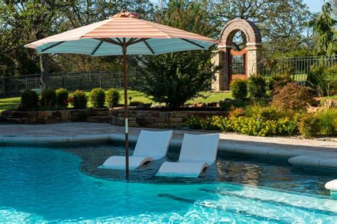 ledge loungers in traditional pool