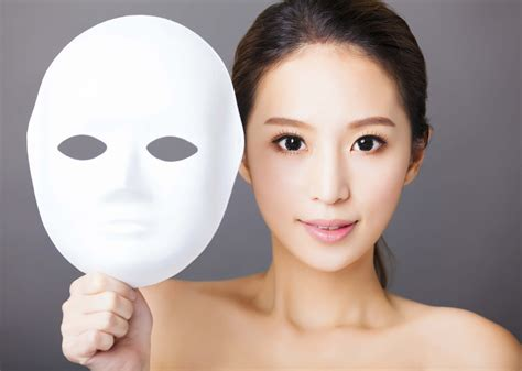 young woman holding white mask  medical beauty concept