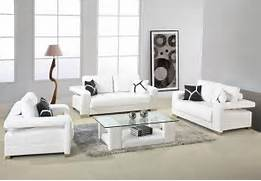 White Leather Sofa With Arms And Glass Top Table For Small Living Room Discover And Download Home Interior Design Ideas And Photo Gallery White Black Camel Brown Gray Living Room Colors Black Living Room Ideas Black Wall Color Black Sofa Table Lamps White