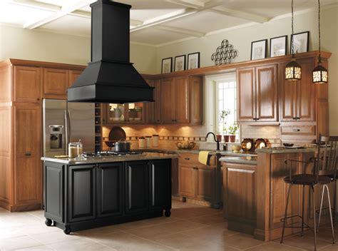oak and black kitchen cabinets light oak cabinets with black kitchen island kitchen