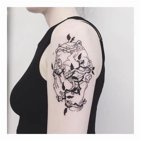hand holding earth tattoo tattoogridnet