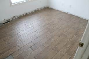 remodel small bedroom spaces with wood plank floor tile