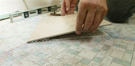 laying tile linoleum glue how to tile a bathroom floor today s homeowner