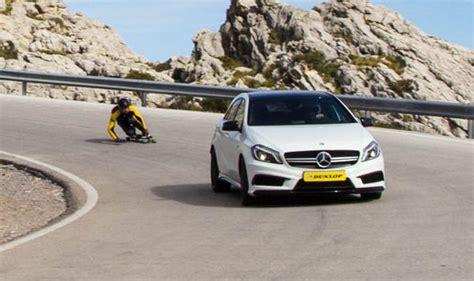 car  longboard race   mountain road