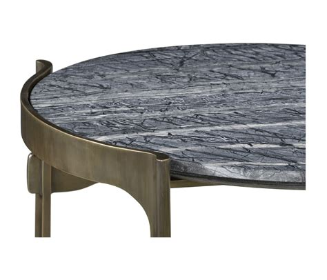 The structure is also equipped with practical hooks positioned under the top. Low Round Solid Brass Coffee Table with a Grey Marble Top - JC Hospitality
