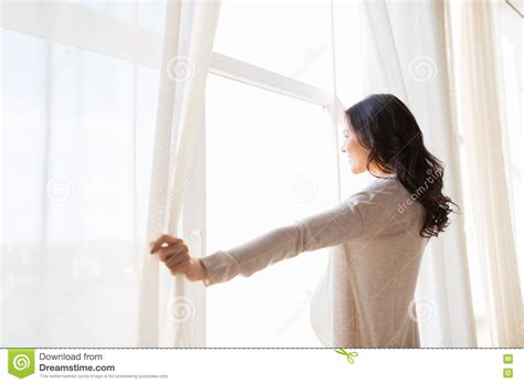 up of opening window curtains stock
