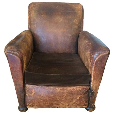 distressed leather chair distressed leather and velvet club chair at 3381