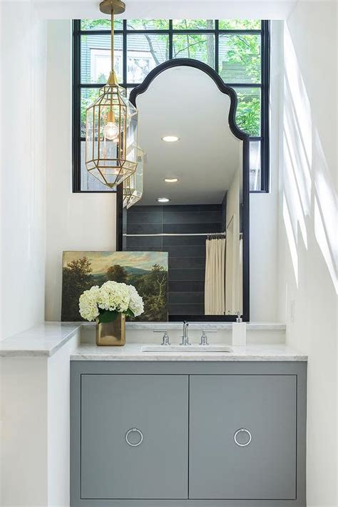 gray vanity with carrera marble countertop and gold