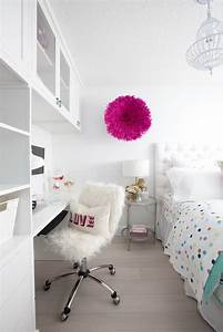 Picture Of white clean room with pops of color and a desk nook