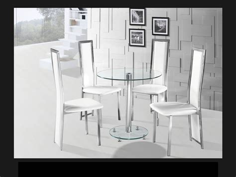 Round clear glass chrome dining table and 4 white chairs