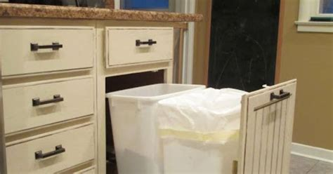 inside cabinet trash can transition from a storage cabinet with two shelves inside