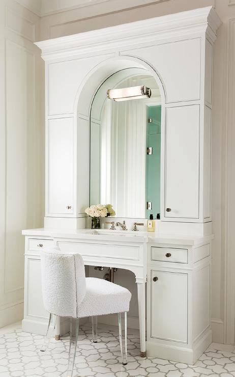 white bath vanity  arched mirror  white terry cloth