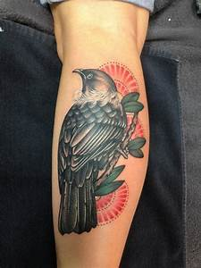 Cool bird on tree tattoo for guys on arm - Tattooimages.biz