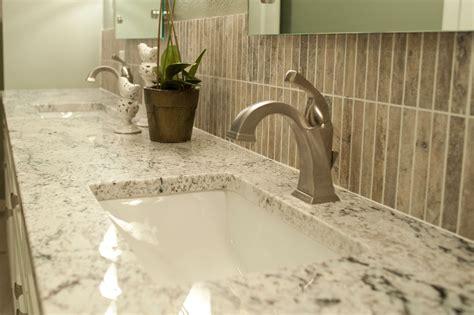 innovative delta dryden in bathroom traditional with white granite backsplash next to white ice