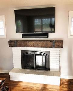 Mantel, With, Metal, Straps, And, Bolts, On, White, Brick, Fireplace