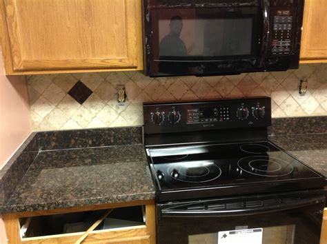 kitchen countertops and backsplash ideas donna s brown granite kitchen countertop w travertine backsplash granix