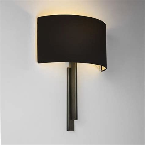 modern hotel style wall light in bronze with black shade
